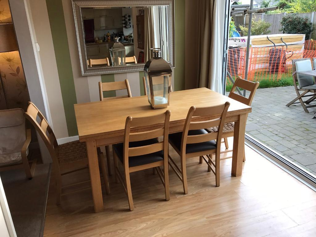 Marks and Spencer's Extendable solid oak dining table and 6 chairs - great quality (8/10 spaces)