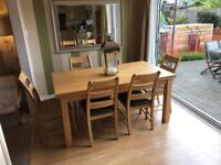 Extendable solid oak dining table and 6 chairs - great quality (8/10 spaces)