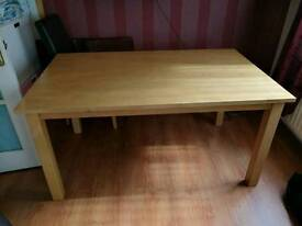 Solid oak table and 6 brown leather chairs.