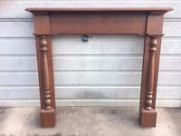 Heavy, solid fireplace surround - mahogany look (includes size in ad)