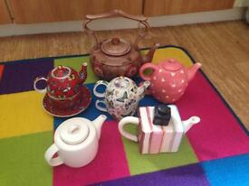 Six collectible tea pots