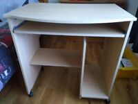 Beech effect Computer desk with pull out shelf and room for hard drive and printer (with wheels)