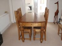 Used Oak Dining Room Table & 4 Chairs, including some fine carving detail on both table and chairs.