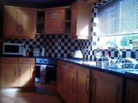 Solid wood maple shaker style kitchen with granite worktop