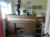Mid-sleeper bunk bed with pull-out desk, bookshelf, wardrobe, ladder, mattress, safety rail