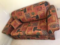 Sofa Bed in good condition with elephant pattern
