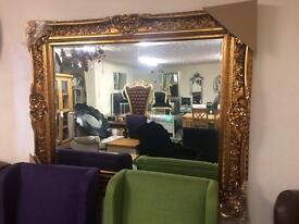 Very large gold framed mirror