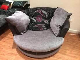 Round lovers sofa with cushions