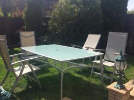 Glass patio table and 4 chairs