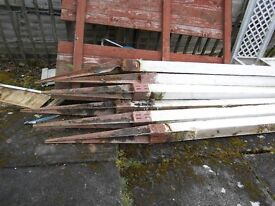 5 metal stakes with wooden posts