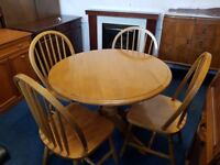 Solid Pine Round Drop Leaf Kitchen table & 4 Spindle back Chairs