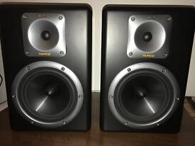 A pair of Tapco s8 active studio monitors by mackie quality monitor speakers