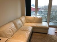 White leather corner sofa (right) from next