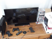 "32"" TV and 160GB PS3 with 25 games"