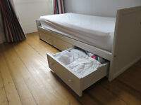 White toddler bed 65x168cm with storage drawers, mattress, and fitted sheets