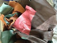 Leather pieces - half a black bag full