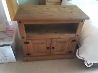 Solid Pine TV Entertainment Unit. Solid but could do with a rub down and wax or varnish.