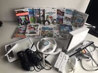Nintendo Wii Bundle includes 2 Controllers,2 Steering wheels,2 Microphones, Wii U Draw & 15 games