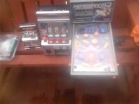 pinball machine and 2 bandits