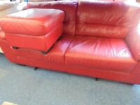 2 SEATER RED LEATHER SOFA AND FOOTSTOOL