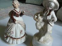 Pair of china musical box figurines. M & Fmale, traditional style, cream, buff, brown colourway