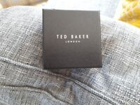 Beautiful Ted Baker ladies watch. Brand new with box. Very pretty with black strap.
