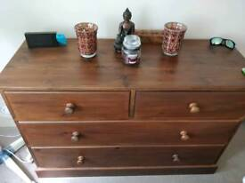 Stained solid pine chest of drawers