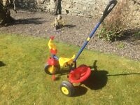 Toddlers trike, red/yellow/blue. With handle
