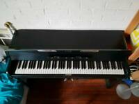Kemble minx upright piano