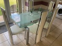 Glass top extending table and 6 high back chairs