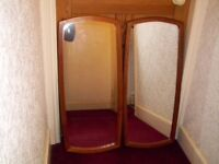 2 Wall Mirrors With Curved Frames.