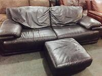 Black leather 2 seater sofa and matching footstool