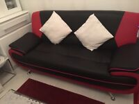 Black and Red Sofa For Sale. Braught new recently however need to sell due to size.