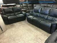 Black leather reclining 2 and 3 seater sofas