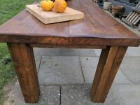 Extra large rustic reclaimed wooden farmhouse table. Dining/kitchen.