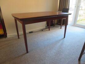 DANISH MID-CENTURY extendable teak dining table, probable Johannes Andersen