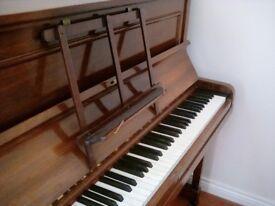 Upright piano, lovely tone