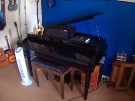 Boxed and ready to go a 88 Graded Hammer Action Digital Grand Piano in Polished Ebony