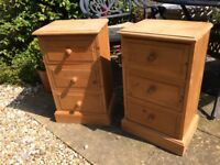 A PAIR OF SOLID PINE 3 DRAWER BEDSIDE CUPBOARDS