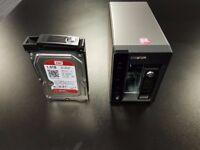 QNAP TS-253 Pro - 2x 1TB WD Red HDD's