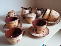 Hand made earthenware tea set from Greece. 6 cups & saucers, 2 jugs, 1 sugar bowl.