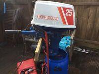 Suzuki Dt 25 Hp short shaft boat outboard engine.