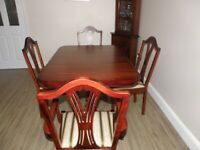 Dining room table and chairs and display cabinet