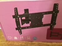 Wall mounted tv stand brand new and in original box - originally bought in error.