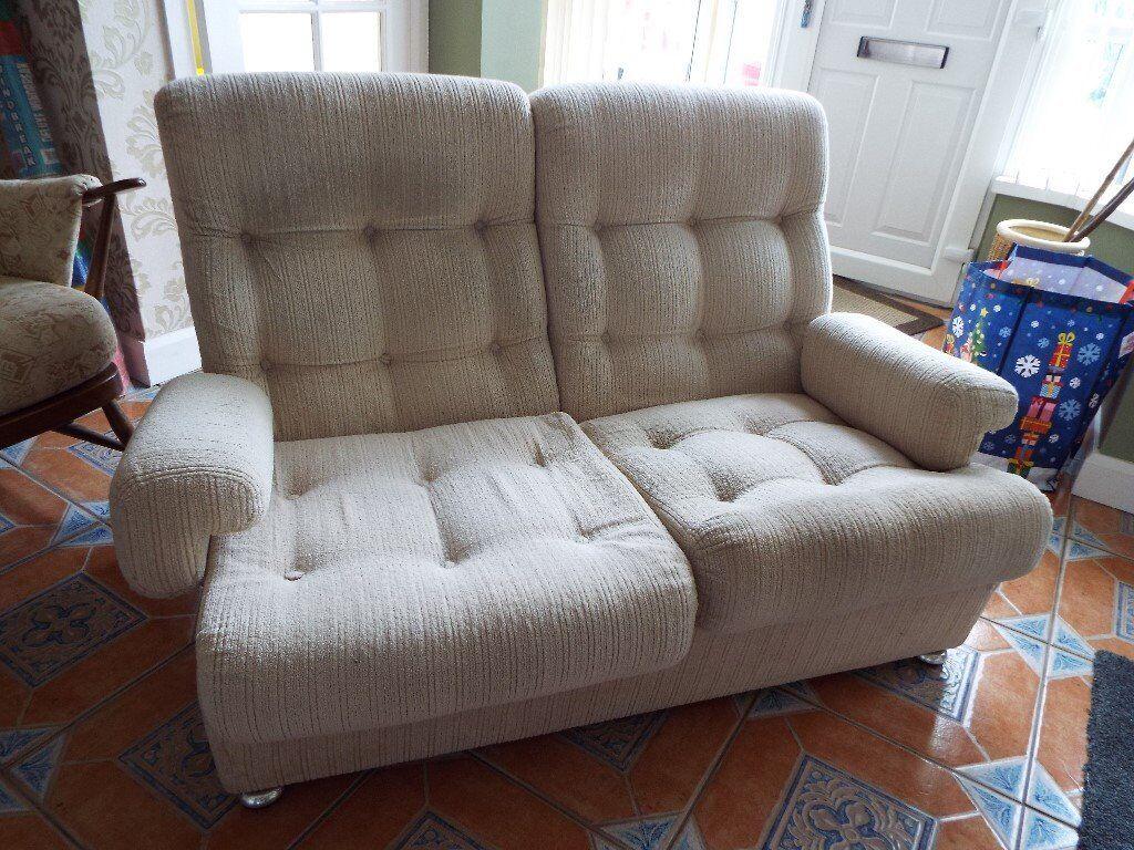 Two seater cream fabric sofa