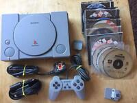 PlayStation 1 console with games. Ps1