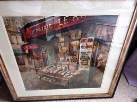 2 Parisian framed prints.