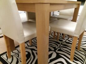 Pine dining table with 4 faux cream leather chairs