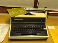 "Adler Electric Typewriter Model 131d 6"" Carriage Elite, working order, with instruction book, cover."
