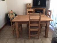 Excellent quality hard wood kitchen/dining table and chairs